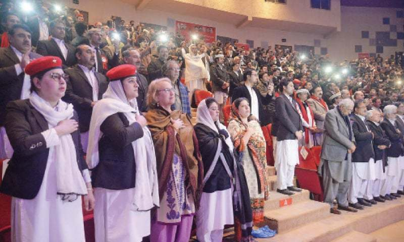 Participants listen to ANP's anthem played during oath-taking ceremony of office-bearers of Malgari Wakeelan in Nishtar Hall, Peshawar, on Saturday. — White Star