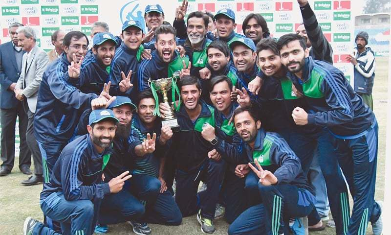 RAWALPINDI: The jubilant Karachi Whites squad members pose with the National One-day Regional Cup after defeating Islamabad in the final at the Pindi Cricket Stadium on Sunday.—PCB