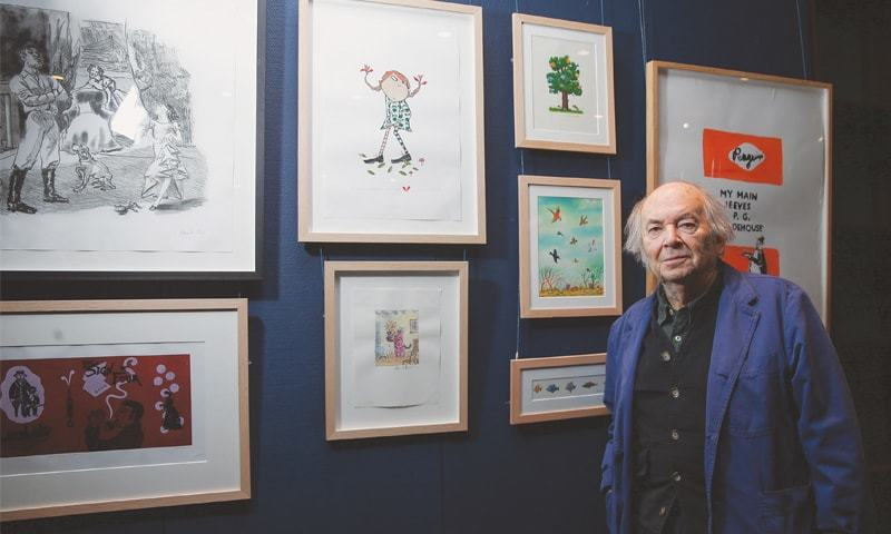BRITISH illustrator Quentin Blake poses with some of his work at Sotheby's auction house in London during an exhibition on Dec 7, 2017.—AFP
