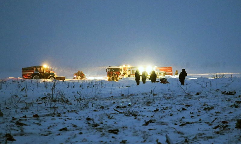 Emergency responders work at the site of plane crash in Ramensky district, on the outskirts of Moscow. —AFP