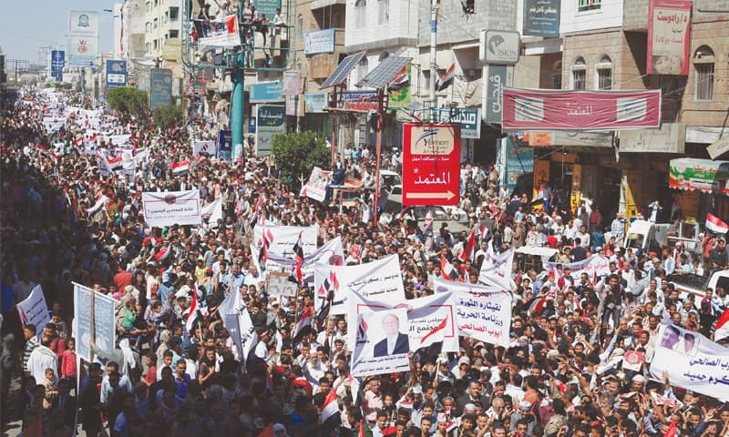 Taiz (Yemen): People take part in a ceremony commemorating the anniversary of the 2011 uprising that toppled former president Ali Abdullah Saleh.—Reuters