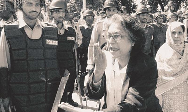 in this October 2007 photo, Asma Jahangir admonishes police personnel at a protest against the Election Commission of Pakistan.—White Star