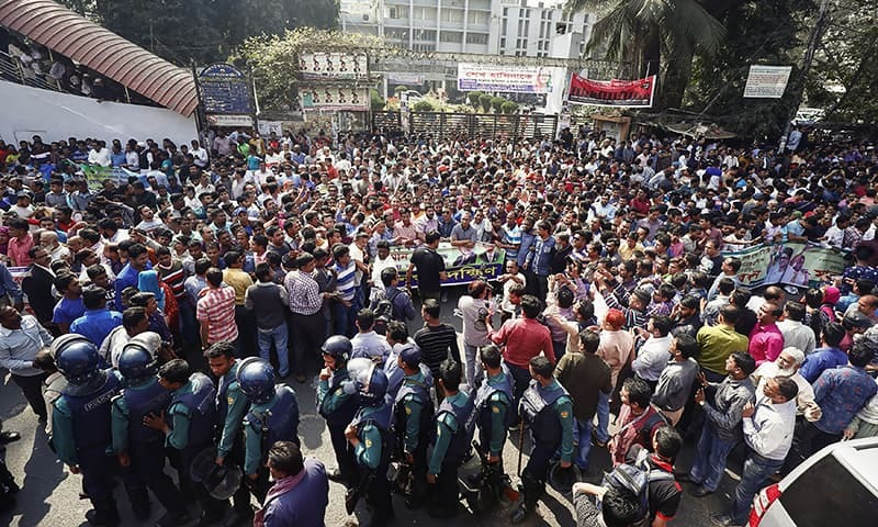 Bangladesh Nationalist Party (BNP) leaders and supporters protest against the verdict in the corruption case of Bangladesh's main opposition leader and BNP chairperson Khaleda Zia in Dhaka on Monday.— AFP