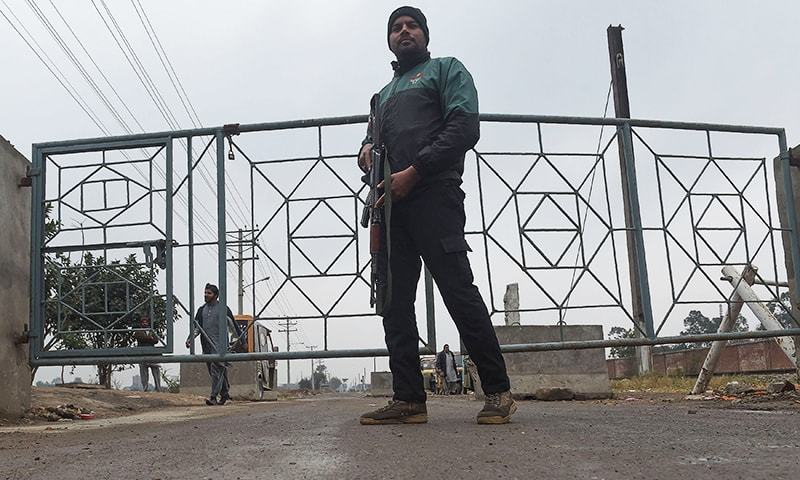 A policeman stands guard outside the check point of Kot Lakhpat Jail where Imran Ali faced charges of rape and murder of Zainab Amin in Lahore on Monday. — AFP