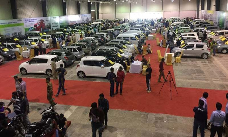 Cars lined up at the Karachi Expo Centre. Auto sales have been rising all last year as demand outstrips supply.—File photo