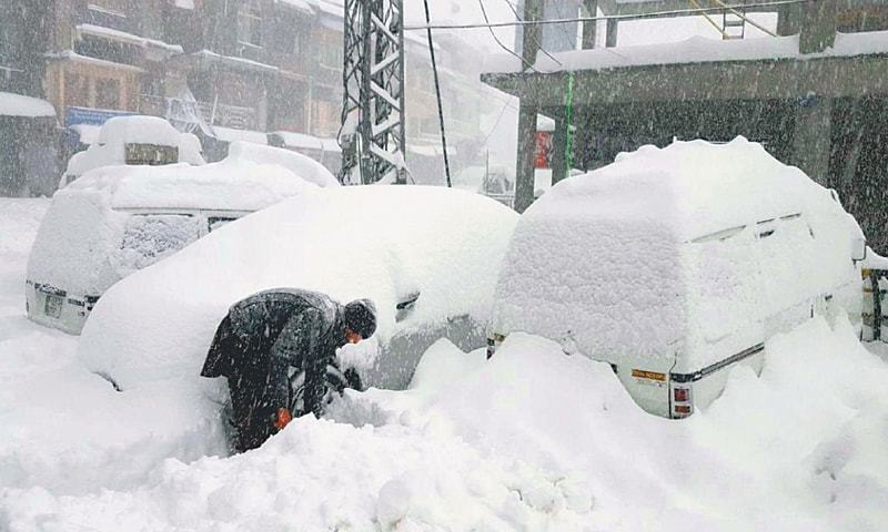 A MAN tries to clear a snowbound road in Abbottabad's Nathiagali Bazaar on Monday. Unusually high levels of snowfall have buffeted large swathes of Khyber Pakhtunkhwa, the tribal areas, northern Punjab and Azad Kashmir over the past few days. People rejoiced over the sight of snow at first, but it was not long before their joy gave way to concern as life virtually ground to a halt. Heavy rains compounded the misery. According to the Met Office, Nathiagali and Malam Jabba have received 18 and 16 inches of snow, respectively. As bad weather left tourists stranded in Murree, the authorities cauti