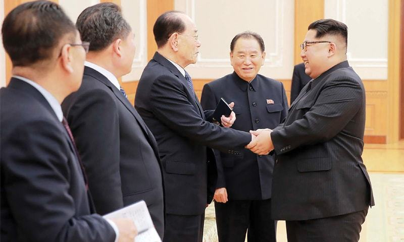 Pyongyang: North Korean leader Kim Jong Un (right) greets members of the high-level delegation that visited South Korea last week to attend the opening ceremony of the Winter Olympics.—AFP