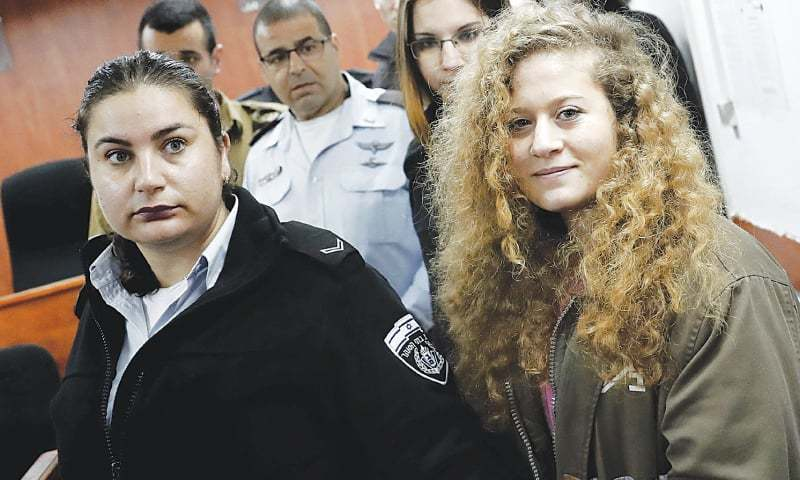 BETUNIA VILLAGE (West Bank): Seventeen-year-old Ahed Tamimi arrives for her trial at a military court here on Tuesday.—AFP