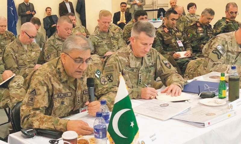 KABUL: Chief of the Army Staff Gen Qamar Javed Bajwa speaks during the conference on Tuesday. Gen John Nicholson, the commander of the coalition forces in Afghanistan, is also seen.—Online