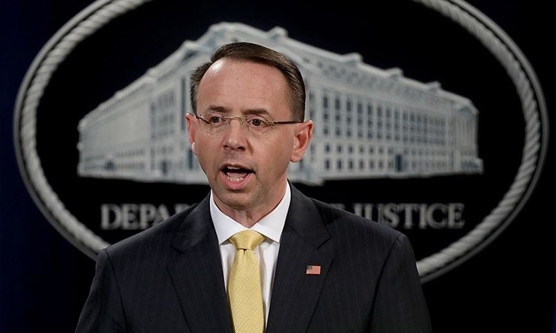 US Deputy Attorney General Rod Rosenstein announces the indictment of 13 Russian nationals and 3 Russian organisations for meddling in the 2016 US presidential election  on Friday at the Justice Department in Washington, DC. — AFP
