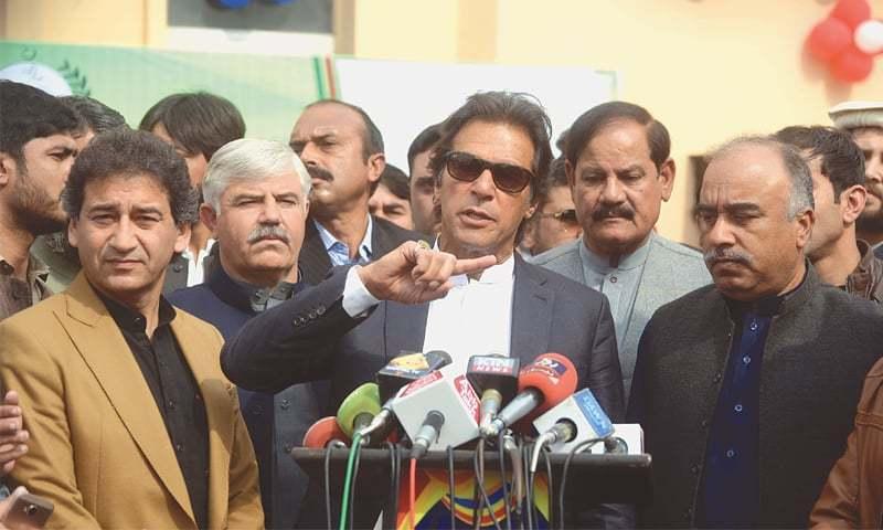 Pakistan Tehreek-i-Insaf chairman Imran Khan talks to the media at the Arbab Niaz Cricket Stadium on Tuesday.—White Star
