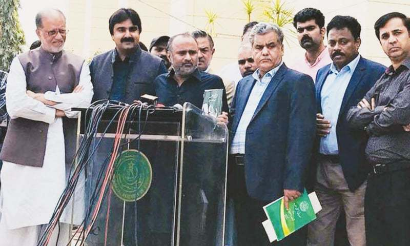LAWMAKERS belonging to the PSP speak to the media outside the Sindh Assembly on Friday.—PPI
