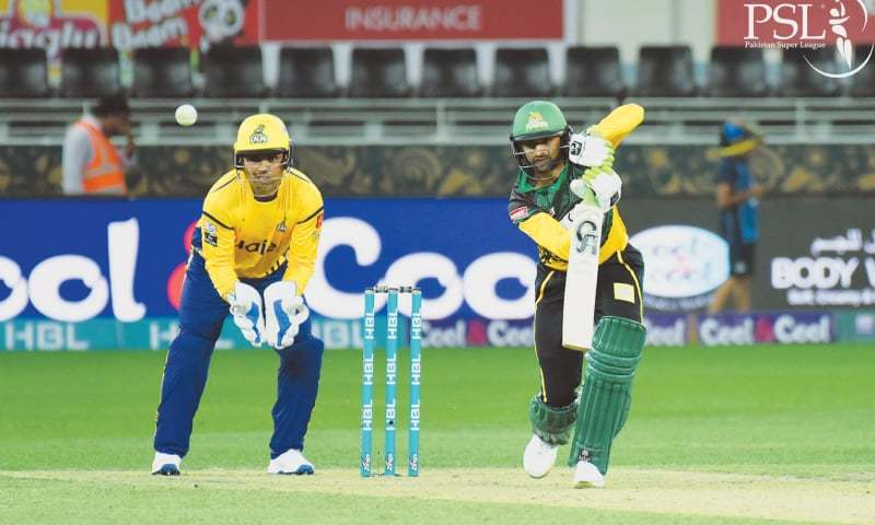DUBAI: Multan Sultans' captain Shoaib Malik plays a shot as Peshawar Zalmi wicket-keeper Kamran Akmal looks on.—courtesy PCB