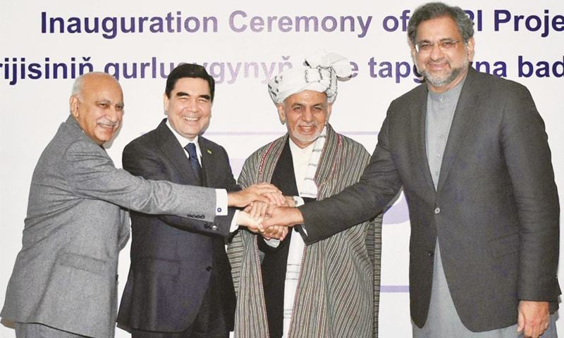 PRIME Minister Shahid Khqan Abbasi joins hands with Turkmen President Gurbanguly Berdimuhamedov, Afghan President Ashraf Ghani and India's Minister of State for External Affairs M.J. Akbar at the inauguration ceremony of TAPI project in Herat on Friday.—Online