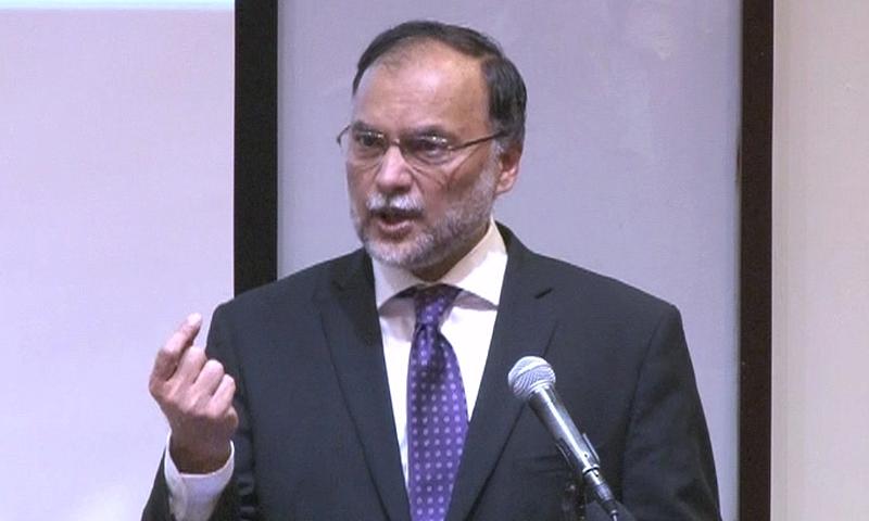 Interior Minister Ahsan Iqbal speaks to reporters on Saturday.— DawnNews