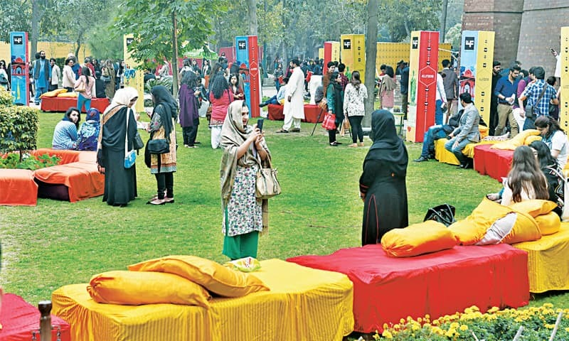 Attendees of the Lahore Literary Festival on the lawns of Alhamra Art Centre. — White Star/M.Arif