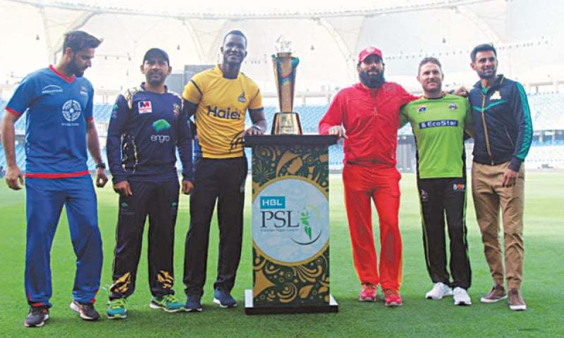 The six PSL team captains pose with the trophy at Dubai Stadium
