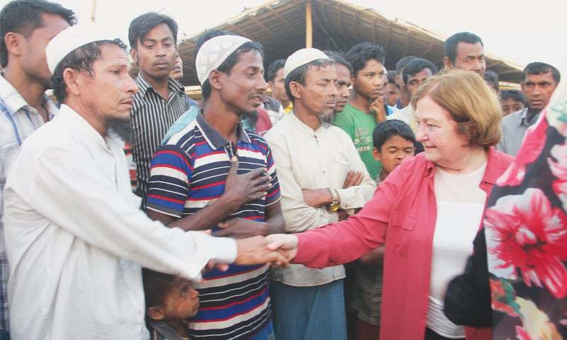 Cox's Bazar: Mairead Maguire (right), a Nobel Peace laureate from Northern Ireland, shakes hand with Rohingya refugees during her visit to a refugee camp on Sunday. Three female Nobel Peace winners began a week-long trip to Bangladesh to meet Rohingya women who were tortured, raped and even killed by Myanmar soldiers.—AP
