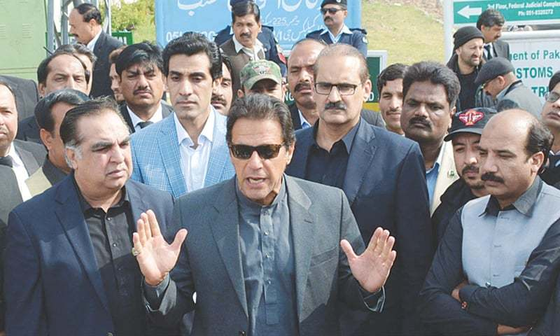 ISLAMABAD: Pakistan Tehreek-i-Insaf chief Imran Khan speaks to the media after appearing before an anti-terrorism court in four cases, including the attack on PTV building and parliament, on Monday.—Online