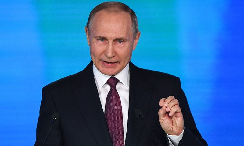Russian President Vladimir Putin addresses the Federal Assembly at Moscow's Manezh exhibition centre on Thursday.— AFP