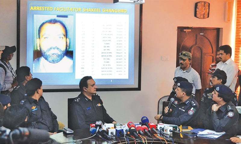DIG JAWED Aalam Odho and SSP Pir Muhammad Shah speak to the media about the militants' arrest during a press conference at the police headquarters on Friday.—APP