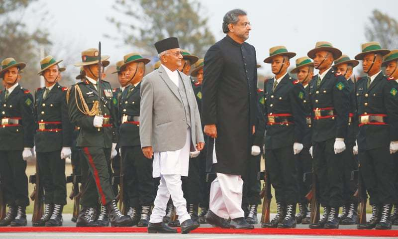 KATHMANDU: Prime Minister Shahid Khaqan Abbasi along with his Nepalese counterpart Khadga Prasad Sharma Oli, also known as K.P. Oli, inspects a guard of honour after his arrival in the Nepalese capital on Monday.—Reuters