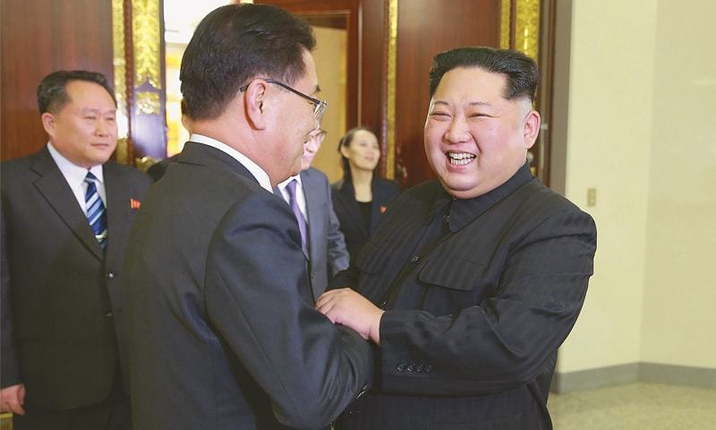 Pyongyang: North Korean leader Kim Jong-Un (right) shakes hands with South Korea's chief delegate Chung Eui-yong (centre) during their meeting on Monday.—AFP