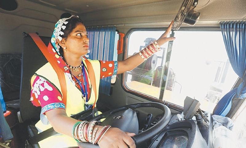 Gulaban, a 25-year-old mother of three, adjusts a fan before driving a 60-tonne truck in Islamkot, Tharparkar, on Sept 21, 2017.—Reuters