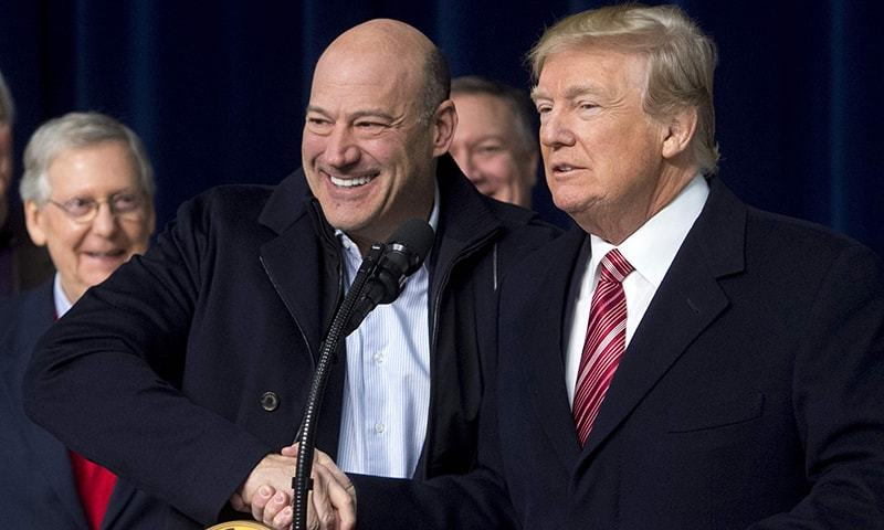 In this file photo taken on January 6 US President Donald Trump shakes hands with Gary Cohn, Director of the National Economic Council, during a retreat with Republican lawmakers and members of his Cabinet at Camp David in Thurmont, Maryland.— AFP/File