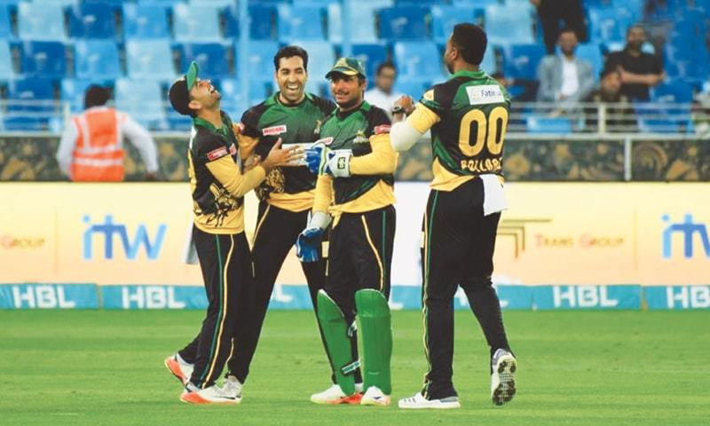MULTAN Sultans' paceman Umar Gul celebrates  with team-mates after a Quatta Gladiators dismissal. —courtesy PSL