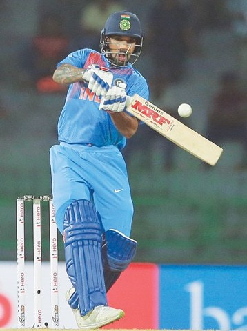 COLOMBO: Indian opener Shikhar Dhawan plays a shot during the tri-nation Twenty20 series match against Bangladesh on Thursday.—AP
