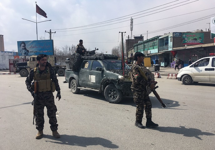 Afghan forces win back western town captured by Taliban in overnight raid