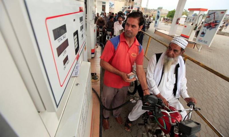 Motorcyclists wait in line at a fuel station in this file photo. The market share of locally produced petrol is 38pc while imported fuel holds 62pc share.—Reuters