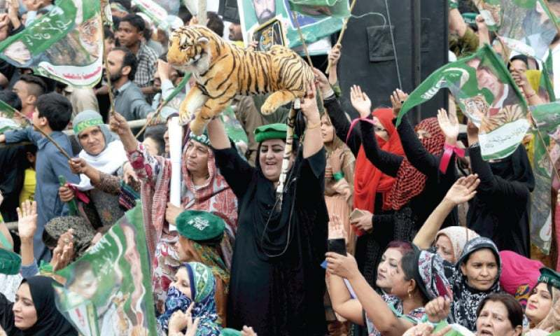 PML-N supporters in a jubilant mood during the convention at Fawara Chowk in Rawalpindi on Sunday. — Photo by Mohammad Asim