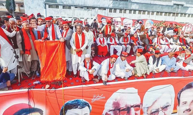 Awami National Party chief Asfandyar Wali Khan addresses a public meeting at Grassy Ground in Swat on Sunday.—Dawn