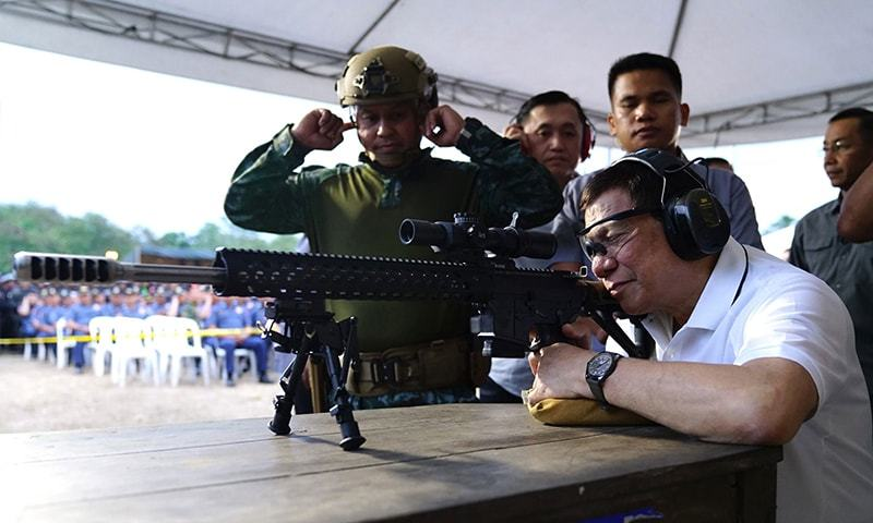 File photo dated March 1, 2018 showing President Rodrigo Duterte firing a few rounds with a sniper rifle during the opening ceremony of the National Special Weapons and Tactics (SWAT) Challenge in Davao City, southern Philippine island of Mindanao. — AFP