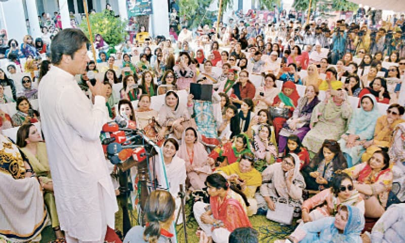 PTI chief Imran Khan addresses women party workers at Royal Palm. — Online