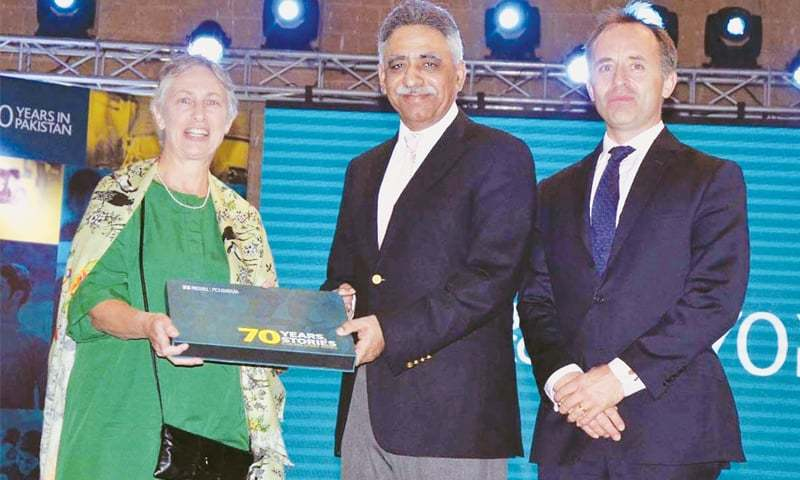 British High Commissioner Thomas Drew and British Council director Rosemary Hilhost present a book to Sindh Governor Muhammad Zubair at Governor House on Wednesday.—APP