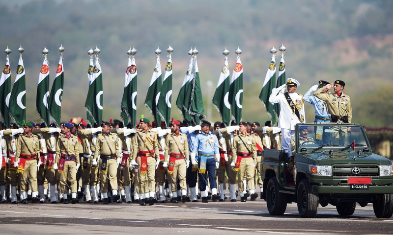Soldiers march past during the Pakistan Day military parade in Islamabad. —AFP