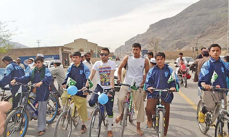 Cyclists participate in a race held in Landi Kotal, Khyber Agency, on Friday. — Dawn
