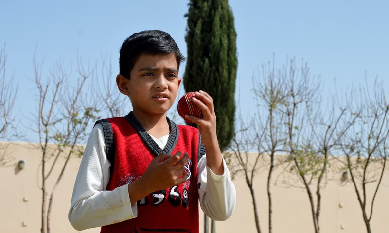 6-year-old Eli Mikail from Quetta practices cricket for two to three hours daily. ─Photo credit: Abdul Waheed