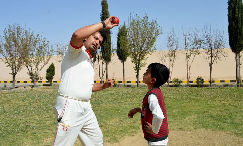 Eli, along with his father and coach, at a park close to their residence in Quetta. ─Photo credit: Abdul Waheed