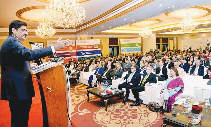 MURAD Ali Shah addresses participants of the development forum on Wednesday.—APP
