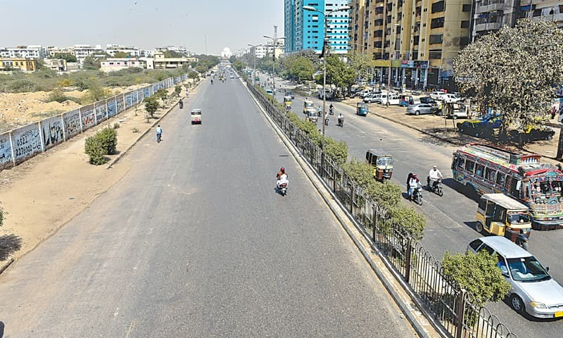 THE usually bustling M.A. Jinnah Road has scant traffic on Thursday afternoon as many people preferred to avoid the scorching heat.—Fahim Siddiqi / White Star