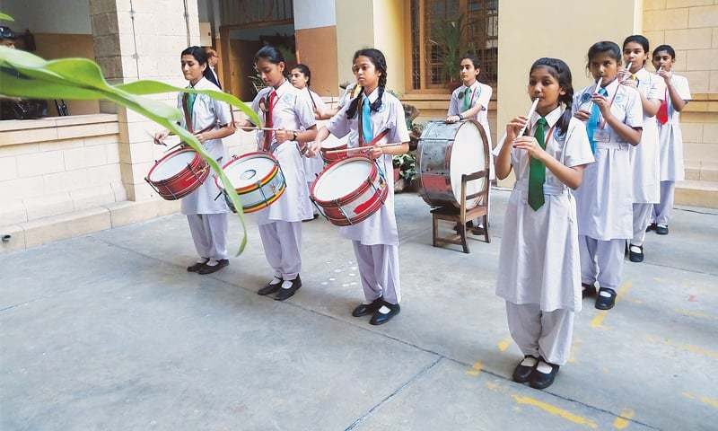The Mama Parsi Girls' Secondary School band plays traditional Pakistani tunes during the school centenary celebrations on Sunday.—Photo by writer