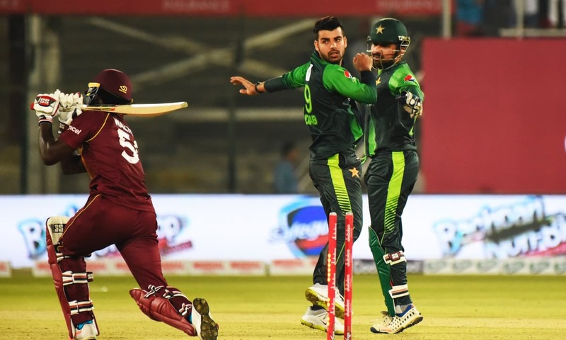 Shadab Khan celebrates with skipper Sarfraz Ahmed after bowling Chadwick Walton out. — Photo courtesy PCB