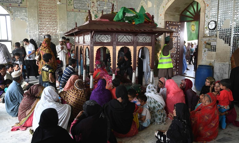 Devotees of the Sheedi group pray at the shrine  — AFP