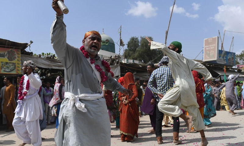 Devotees of the Sheedi ethnic group play traditional music — AFP