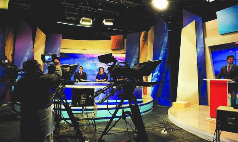 A news programme is under way at PTV's Islamabad studio. Prior to the opening up of private TV channels in the early 2000s, PTV was the only source of news and entertainment. In its early days, 20-minute news bulletins in Urdu and English were broadcast from every centre. Khabarnama, a 25-minute news programme which was aired every night at nine p.m., began in 1970, initially from the Karachi. It became one of the most watched programmes in Pakistan. Commercials which ran prior, during and after Khabarnama were charged a premium. (photo: Arif Mahmood/Dawn White Star)