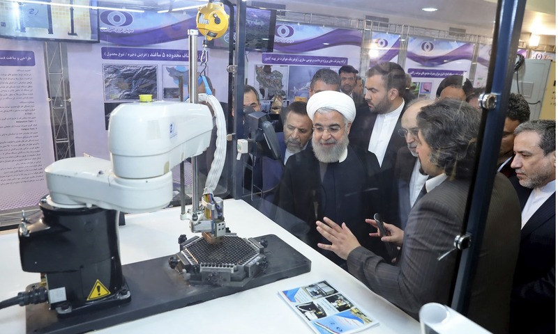 Hassan Rouhani is briefed about nuclear achievements during a ceremony in Tehran to mark